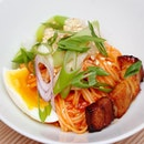 [Chow Fun] - The traditional Korean bibim guksu is a cold noodle dish but Chow Fun's piquant rendition of Pork Belly Bibum Guksu ($2.90) is served warm with gochujang stirred into the rice noodles with house made pickled radish with coriander seeds, and crowned with unctuous silvers of sateed soy ginger glazed pork belly.