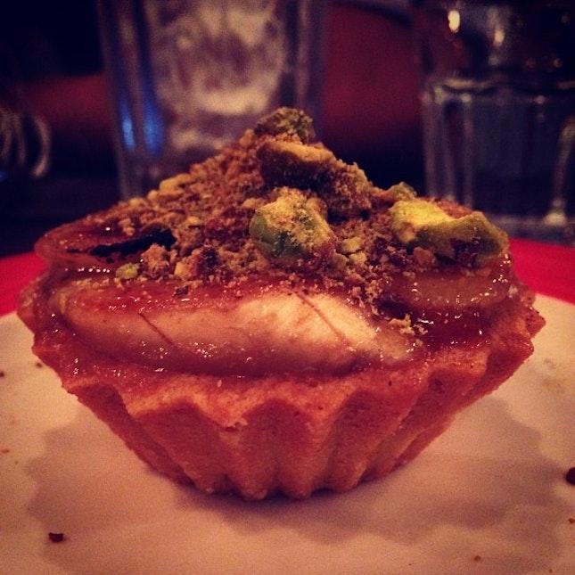 Caramelized Banana Earl Grey Tart #caramel #banana #earlgrey #pistachio #nuts #tart #fruits #dessert #instadessert #instafood #foodporn #foodpic #potd #picoftheday #november #cafe #hopping #cafehopper #instapic #instatag #instalike #instadaily #igsg #sgig #burpple #lolascafe #singapore #iphone5c #igfame