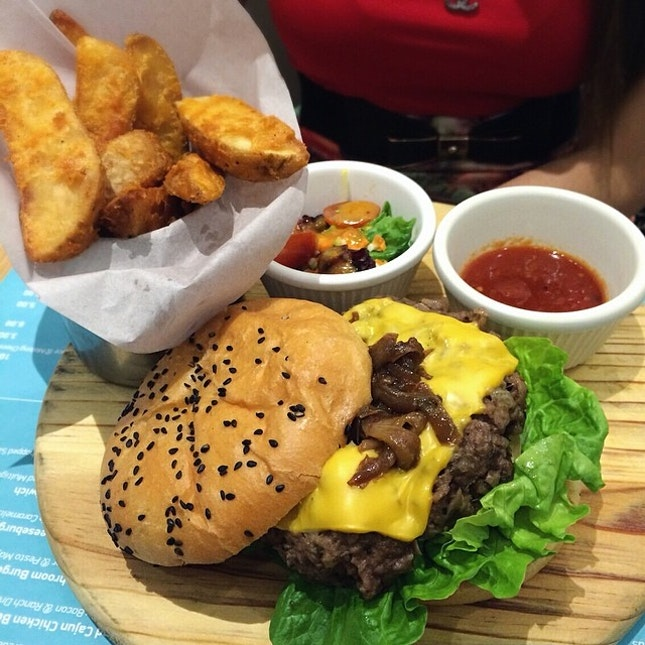 Seriously Delicious Cheeseburger x 100% Beef Burger topped with Caramelised Onions & Cheese served with side salad and potato wedges.