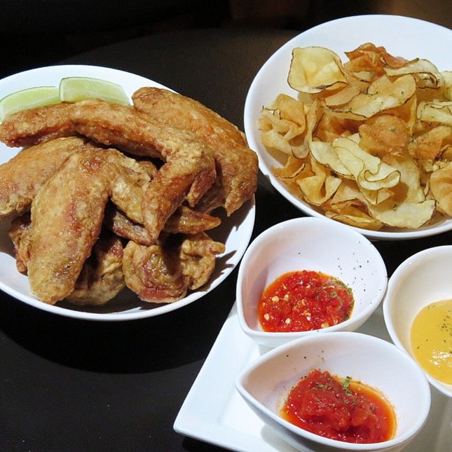 Belly up to some of the city's best bar food - KPO wings and their legendary potato chips.