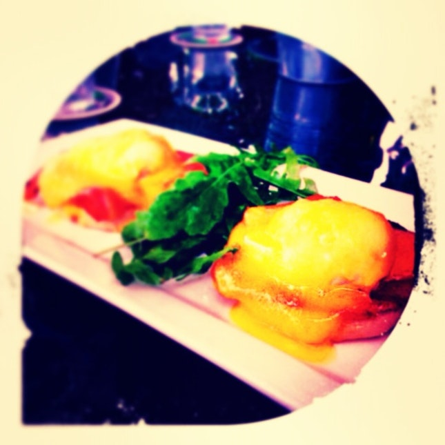 eggs benedict with smoked ham and hollandaise sauce.