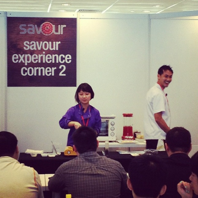Watching Chef Nicole Loh and Chef Julius Tan demo-ing Buah Keluak something Lemongrass.