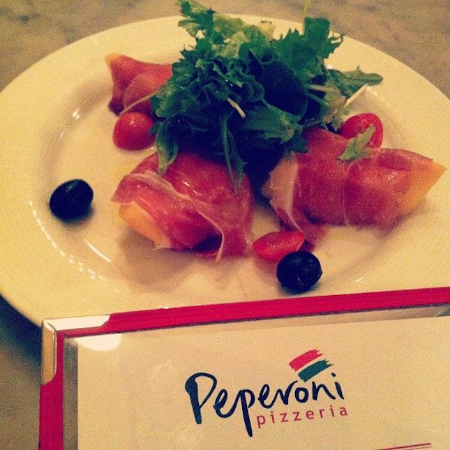 Prosciutto Crudo Di Parma E Melone (rockmelon wrapped with Parma ham)