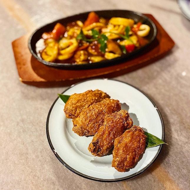 Prawn paste chicken wings ($10), sambal sotong ($12).