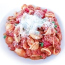 Love is eating a plate of pasta (orecchiette, minced pork, chorizo, scallop, et al) with just the fork.